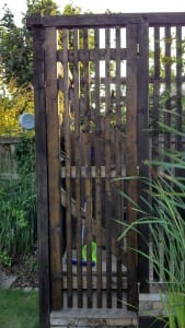 Garden gate with hidden magnetic latch using two countersunk, rubber-coated neodymium magnets.