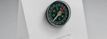 Bespoke greeting card with an attached compass that reads 'lost without you'