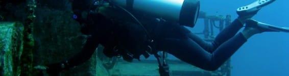 A scuba diver exploring a shipwreck