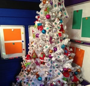 Magnetic noticeboards behind a decorated Christmas tree