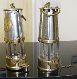 Left: Regular miners safety lamp with magnetic lock and magnet. Right: Deputy's safety lamp.