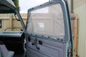 Camper van insect screen fixed in place using high-powered neodymium skittle magnets.