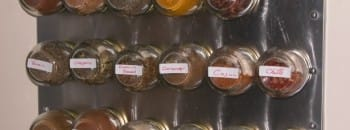 Mounted magnetic spice rack.