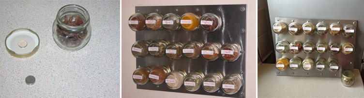 Magnetic spice jars against a steel board