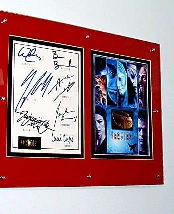 Farscape signed picture in a glass clip frame held together with rivets and hung on a metal wall with ferrite channel magnets