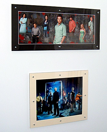 Dexter and Breaking Bad pictures in clip frames held together with rivets and stuck to a metal wall with ferrite channel magnets