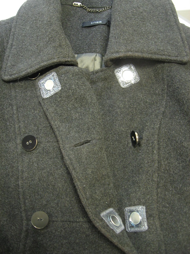 A coat with stitch-in magnets placed behind the buttons