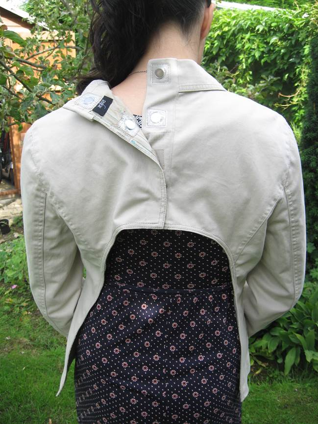 Jacket with back panel removed and split in the back with magnet fasteners