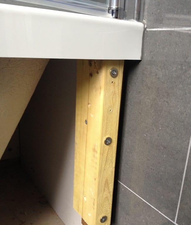 Countersunk steel discs screwed into a bath panel timber frame