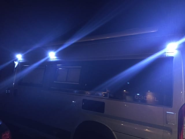 illuminated solar-powered lights on the outside of a motorhome