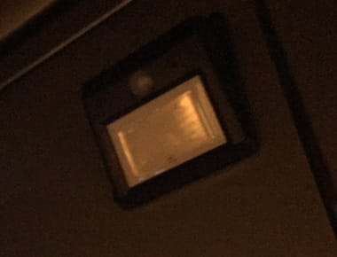 solar-powered light attached to the sliding door of a motorhome with magnets