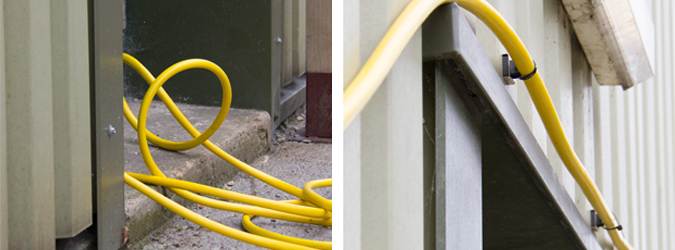 Before and after of an untidy hose mounted against a steel clad wall