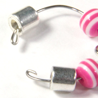 Beads charms and magnetic clasp on a memory wire ring