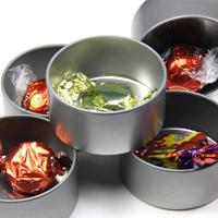 Chocolates inside favour tins