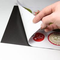 Sticking printed designs onto self-adhesive magnetic sheet