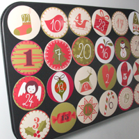 Cake tray Advent calendar stuck to fridge