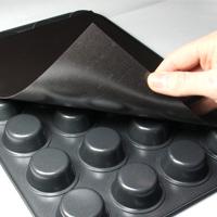 Sticking self-adhesive magnetic sheet to back of cake tray