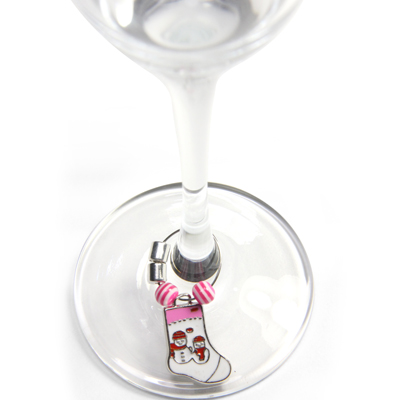 Wine glass with magnetic charm around the stem