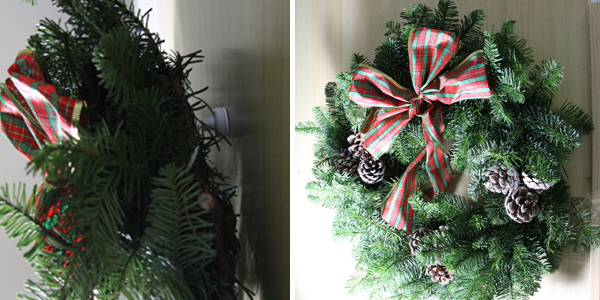 Natural rustic Christmas wreath hung on wooden door using self-adhesive steel disc and white hook magnet