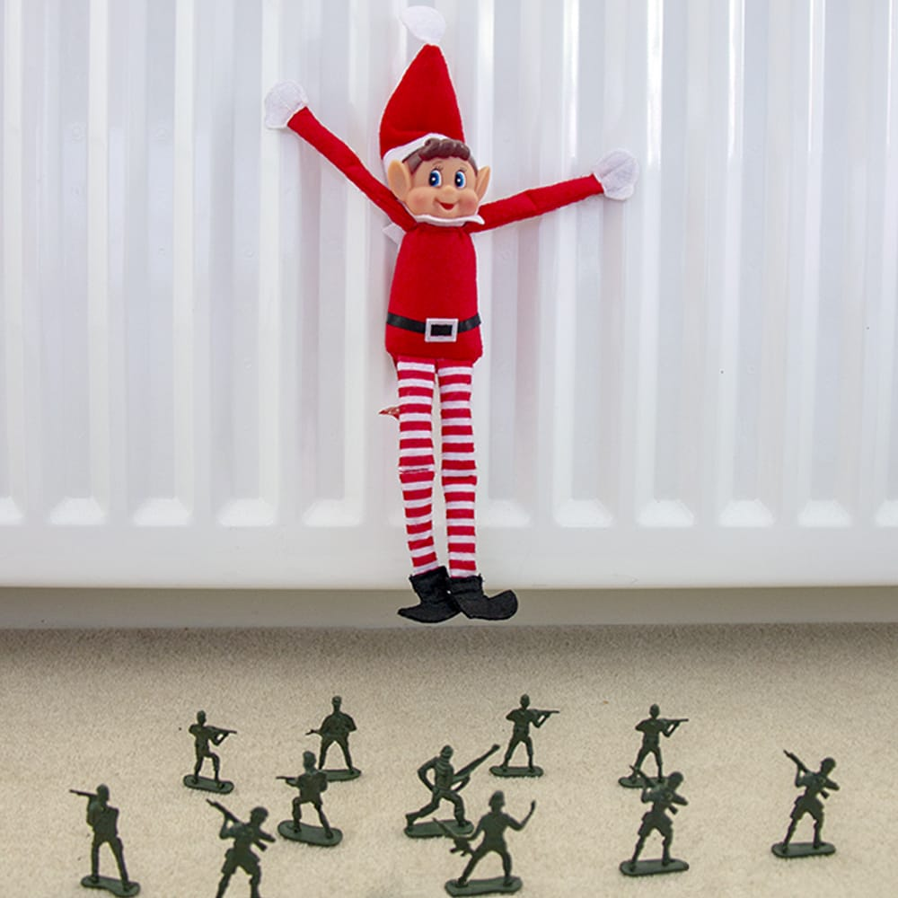 Elf on the shelf hanging from a radiator