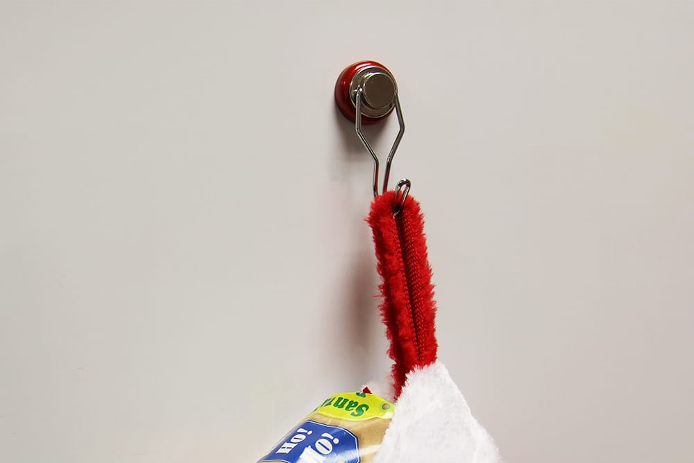 Hang a Christmas stocking with magnets